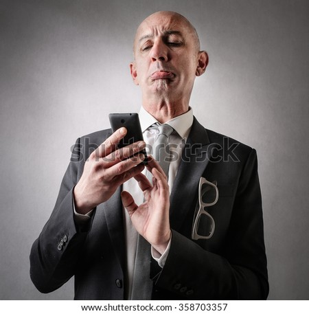 Businessman using a smart phone - stock photo