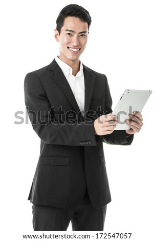Businessman using a tablet - stock photo