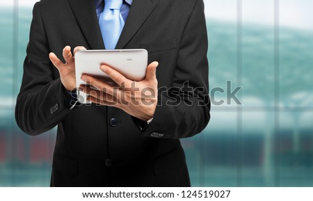 Businessman using a tablet pc - stock photo