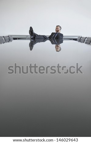 Businessman using cellphone with feet up on table in conference room - stock photo