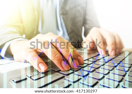 businessman using computer notebook  with graph layer effect selective focus at finger,business technology concept - stock photo