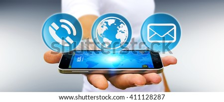 Businessman using contact and email application with his phone - stock photo