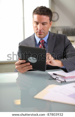 Businessman using digital tablet - stock photo