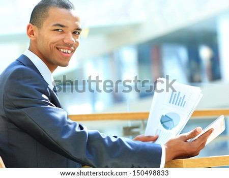 Businessman using digital tablet computer with documents. New technologies for success workflow concept. - stock photo