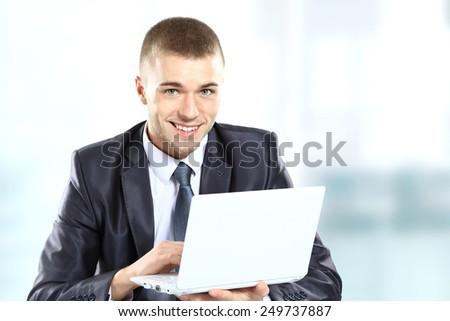 Businessman using laptop - stock photo