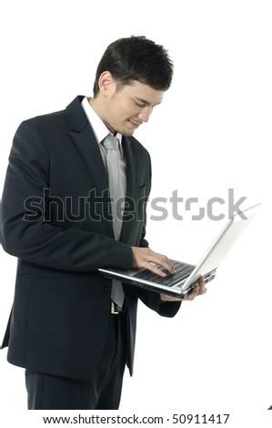 Businessman using laptop computer - stock photo