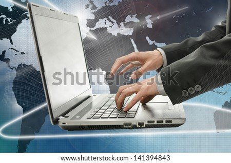 Businessman using laptop in interactive space. - stock photo