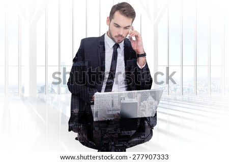 Businessman using laptop while phoning against high angle view of city - stock photo