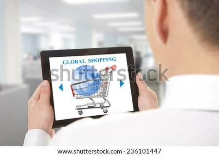 Businessman using laptop with online global shopping cart on screen - stock photo