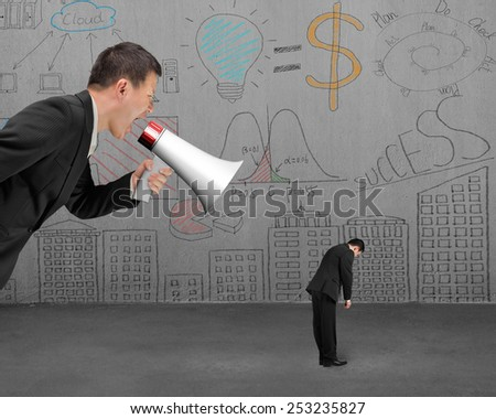 Businessman using megaphone yelling at his employee with doodles wall background - stock photo