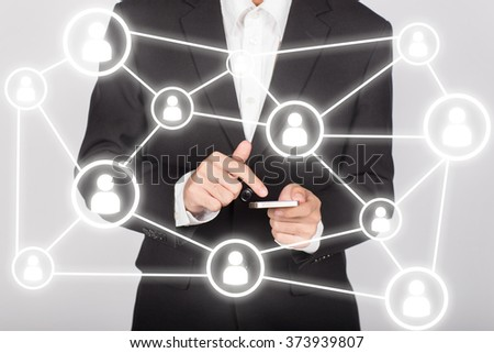 businessman using mobile show social network structure  - stock photo