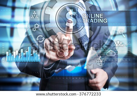 businessman using modern computer and select online trading icon on virtual screen. business, technology and internet concept. - stock photo