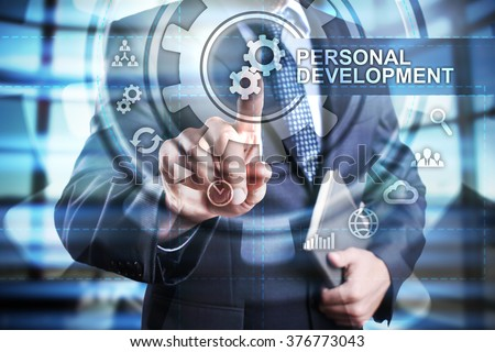 businessman using modern computer and select personal development icon on virtual screen. business, technology and internet concept. - stock photo