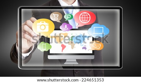 Businessman using multimedia interface with his fingers - stock photo