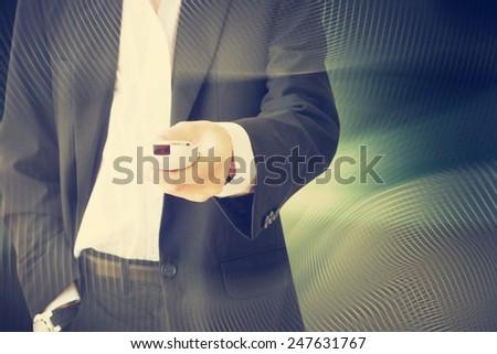 businessman using remote control - stock photo