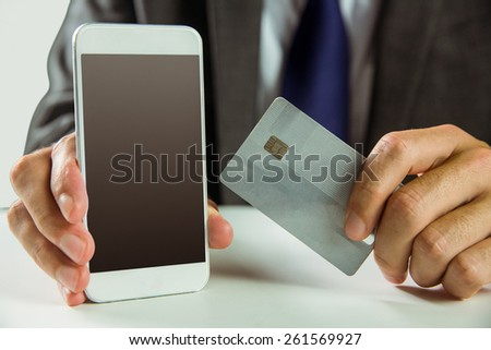 Businessman using smartphone for online shopping in close up - stock photo