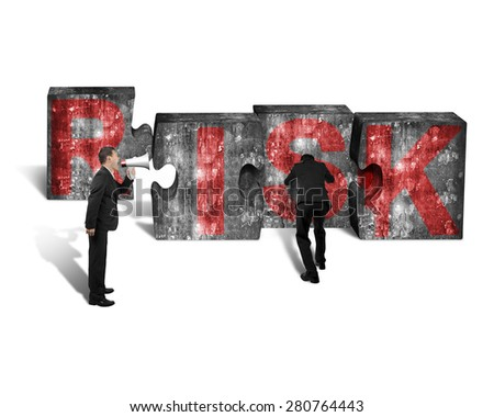 Businessman using speaker yelling at other man pushing big jigsaw puzzle concrete blocks with red RISK word, isolated on white background - stock photo