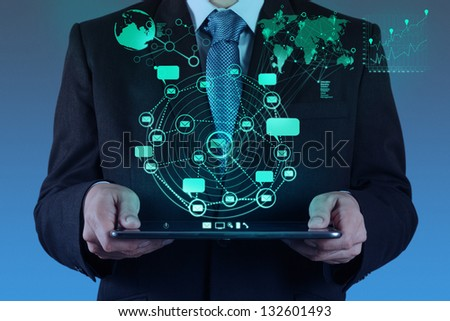 businessman using tablet computer shows internet and social network as concept - stock photo