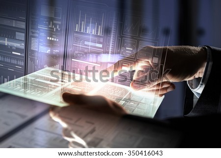Businessman using tablet over virtual interface background - stock photo