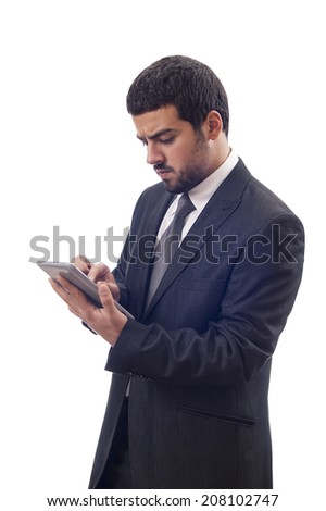 Businessman using tablet pc.isolated with clipping path.  - stock photo