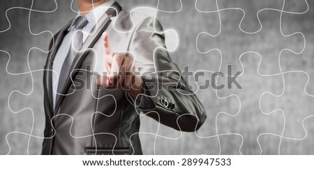 Businessman using tablet showing jigsaw piece, business decision concept - stock photo