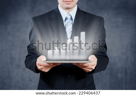 Businessman using tablet with digital visual object, business - stock photo