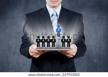 Businessman using tablet with digital visual object, human resource concept - stock photo