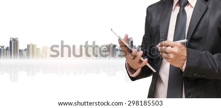 Businessman using the tablet on cityscape background,Business concept - stock photo