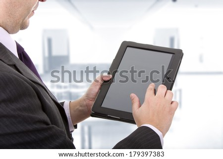 businessman using touch pad, close up shot - stock photo