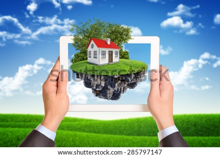 Businessman using white tablet on nature background - stock photo