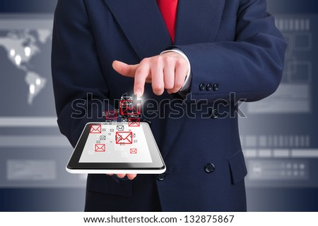 businessman using wireless technology with a computer device - stock photo