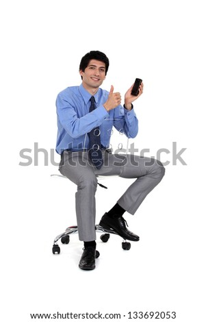 businessman very satisfied with his cell - stock photo