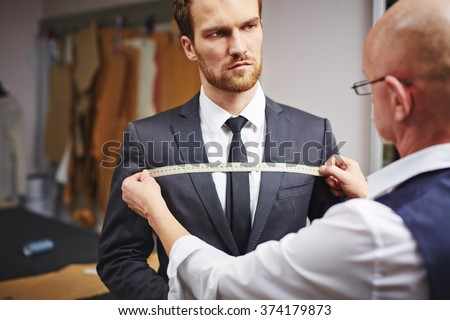 Businessman visiting tailor - stock photo
