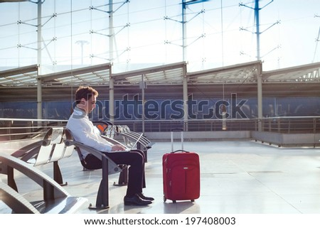 businessman waiting in the airport with laptop - stock photo
