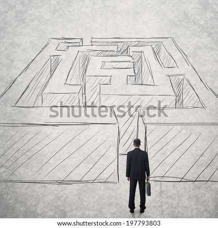Businessman walk into a difficult maze. Photo compilation with hand drawn background. - stock photo