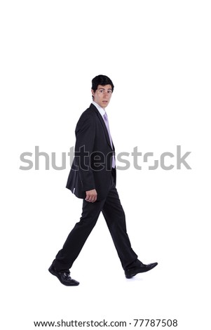 Businessman walking and looking to you isolated on white (some motion blur) - stock photo