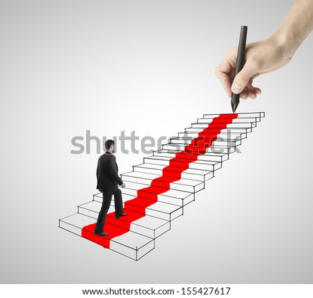 businessman walking on drawing ladder with red carpet - stock photo