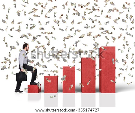 businessman walking on red concrete growth chart and falling dollar bills - stock photo