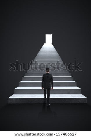 businessman walking on steps to door - stock photo