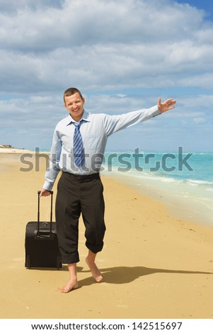 Businessman walking on the beach the first day of vacation - stock photo