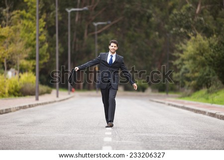 Businessman walking on the road line - stock photo