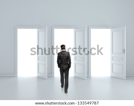 businessman walking to opened three door - stock photo