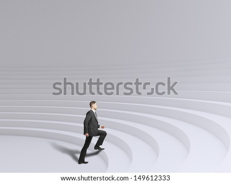 businessman walking up stadium stairs - stock photo