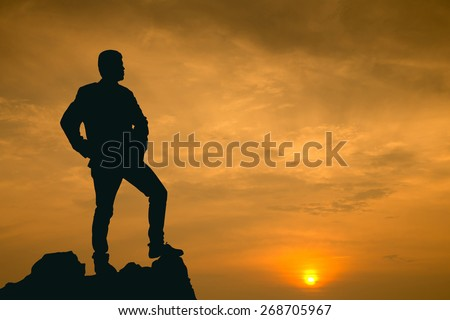 Businessman watch for his vision on the high mountain - stock photo