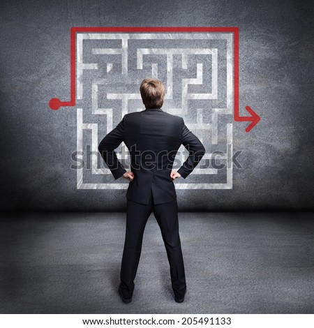 businessman watching a workaround of a problem - stock photo