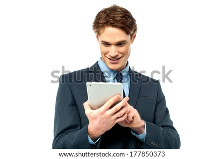 Businessman watching videos on tablet device - stock photo