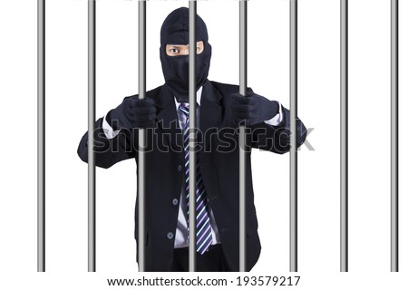 Businessman wearing a mask in jail. Isolated on white background - stock photo