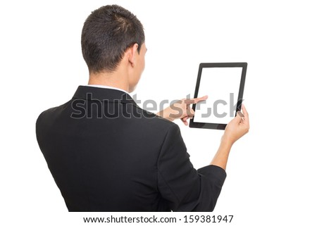 Businessman wearing black suit using tablet computer - stock photo