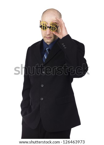 Businessman wearing dollar glasses isolated on white - stock photo