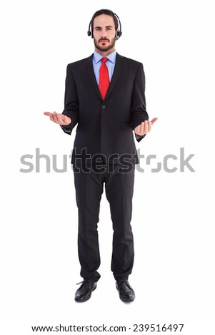 Businessman wearing headphone while holding with hands on white background - stock photo